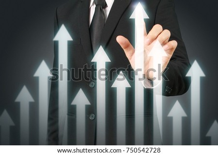 businessman with financial symbols coming from hand ,touch chart stock #750542728