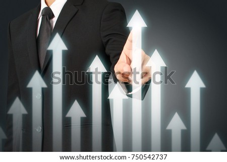 businessman with financial symbols coming from hand ,touch chart stock #750542737