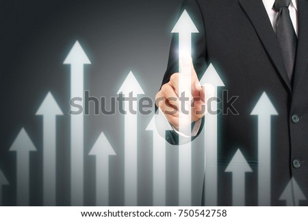 businessman with financial symbols coming from hand ,touch chart stock #750542758