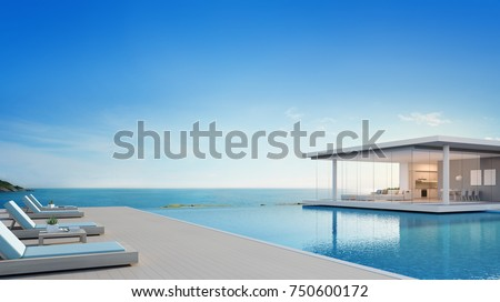 Luxury beach house with sea view swimming pool and terrace in modern design, Lounge chairs on wooden floor deck at vacation home or hotel - 3d illustration of contemporary holiday villa exterior #750600172