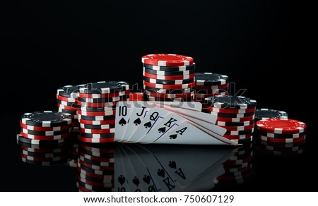 on a black background,  big bet for playing cards on money Royalty-Free Stock Photo #750607129
