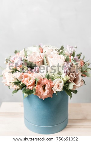 Luxury bouquets of mix flowers in the hat box. vintage color #750651052
