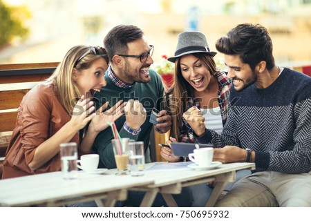 Group of four friends having fun a coffee together after shopping #750695932