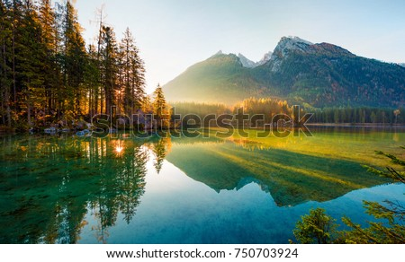 Wonderful autumn sunrise of Hintersee lake. Amazing morning view of Bavarian Alps on the Austrian border, Germany, Europe. Beauty of nature concept background. Royalty-Free Stock Photo #750703924