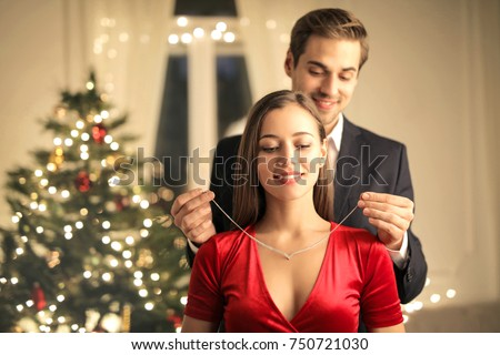 Handsome guy gifting a beautiful necklace to his girlfriend #750721030