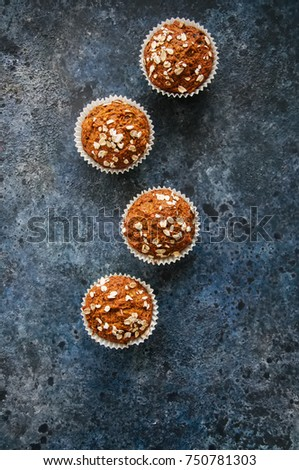 Healthy carrot cake muffins on a blue stone background. Top view. #750781303