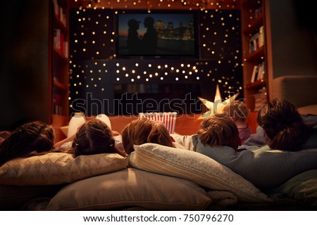 Family Enjoying Movie Night At Home Together Royalty-Free Stock Photo #750796270