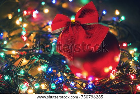 Christmas ball and garland with colored lights. Winter holidays. New Year. #750796285