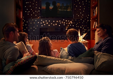 Family Enjoying Movie Night At Home Together #750796450