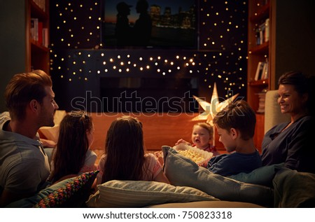 Family Enjoying Movie Night At Home Together #750823318