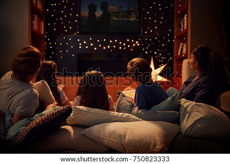 Family Enjoying Movie Night At Home Together #750823333