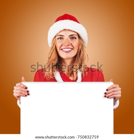 beautiful christmas woman holding a white board with empty copy space for text #750832759