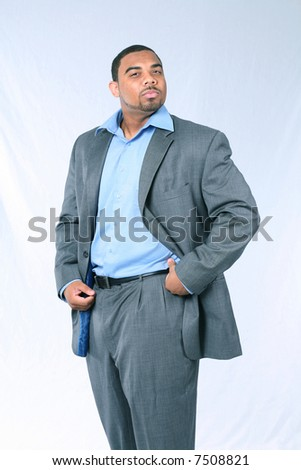 African-American businessman with mustache and beard in suit looking pompous #7508821