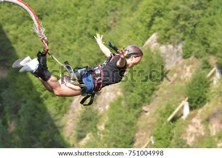 Bungee jumps, extreme and fun sport.  #751004998