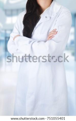 Female doctor on hospital background #751055401
