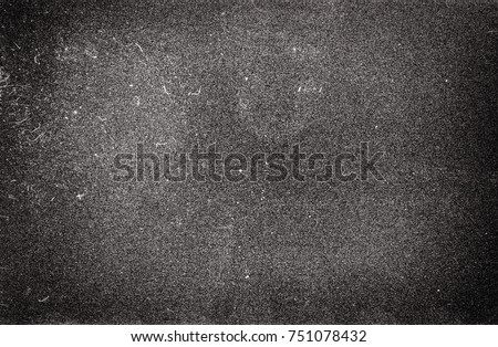 Blank grained film strip texture background with heavy grain and dust Royalty-Free Stock Photo #751078432