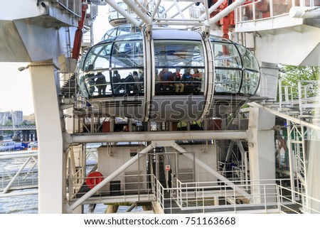 LONDON, GREAT BRITAIN - MAY 15, 2014: It is a fully enclosed glass passenger capsule of the London Eye. #751163668