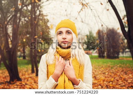 Pretty Autumn Woman with Yellow Cotton Scarf and Hat Outdoors #751224220