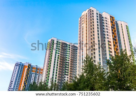 Cityscape on the clear blue sky: bright color high-rise buildings for living Royalty-Free Stock Photo #751235602