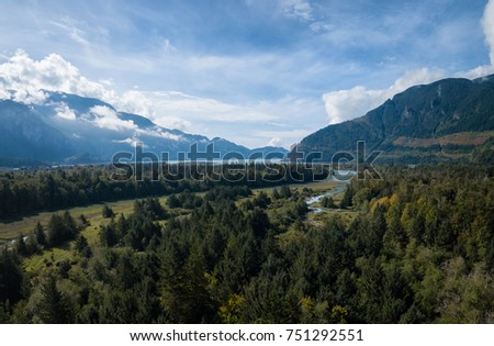 Aerial drone panoramic view of the beautiful Canadian nature landscape during a bright summer day. Taken near Squamish, North of Vancouver, British Columbia, Canada. #751292551