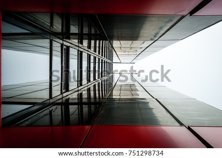 Abstract image of glass and black steel building. Architectural exterior facade and detail. Abstract color background. Modern architecture and design #751298734