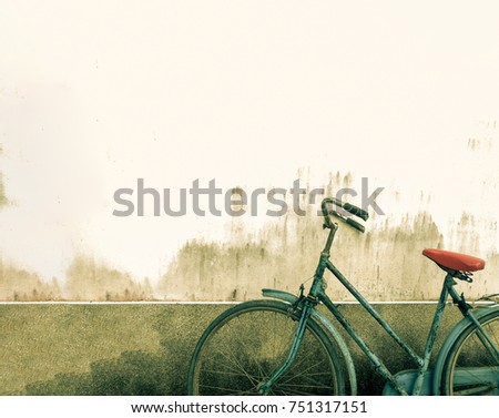 Old rustic bicycle with cement concrete wall background at the park #751317151
