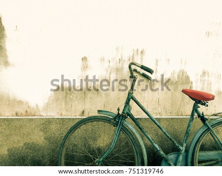 Old rustic bicycle with cement concrete wall background at the park #751319746