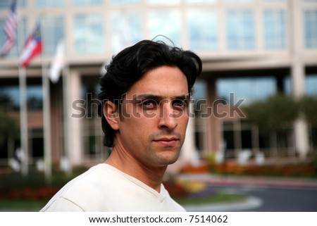 Man in casual business atire standing outside #7514062
