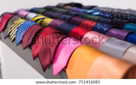 row of Neckties on hangers in men clothing store #751416085