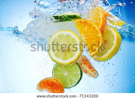 tropical fruits fall deeply under water with a big splash #75143200