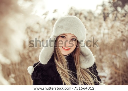 Winter portrait of cheerful young pretty girl. Seasons, outdoor, beauty concept #751564312