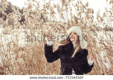 Winter portrait of cheerful young pretty girl. Seasons, outdoor, beauty concept #751564369