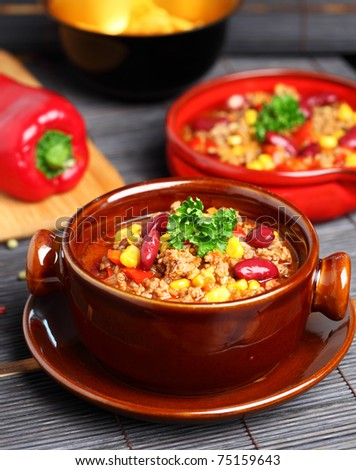 Bowl of chili with peppers and beans #75159643