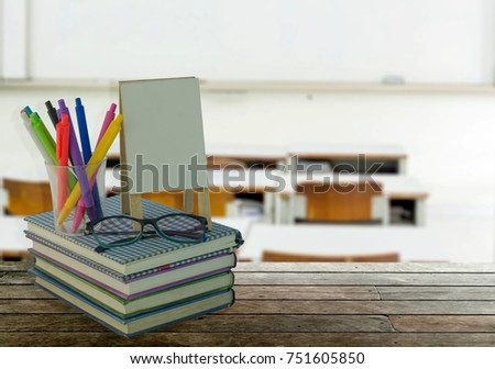 School, literacy and education objects with greeting card in picture frame, eyeglasses, pens over school and education background