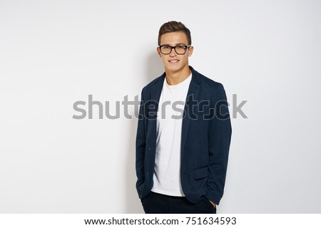 business man looking at the camera, studio                                Royalty-Free Stock Photo #751634593
