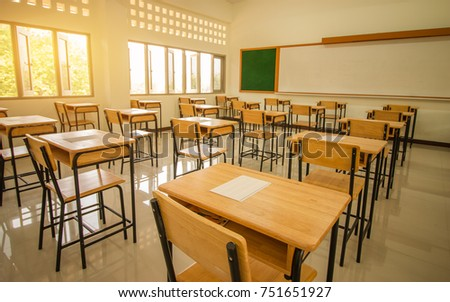School empty classroom with test sheet or exams paper on desks chair wood and greenboard at high school thailand, education test concept Royalty-Free Stock Photo #751651927
