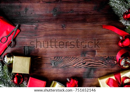 packaging christmas gifts in boxes on wooden background top view #751652146
