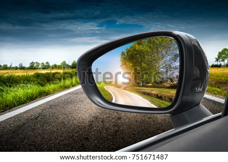 Reflected road in rearview mirror Royalty-Free Stock Photo #751671487
