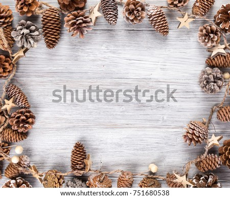 frame with pine cone and white background #751680538