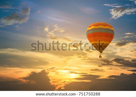 Hot air balloon in the sky sunset background for design #751750288
