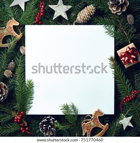 Creative frame of Christmas tree branches and decorations with square blank card. Top view. Xmas and New year concept