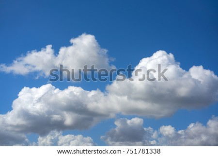 Blue summer sky white cumulus clouds background Royalty-Free Stock Photo #751781338