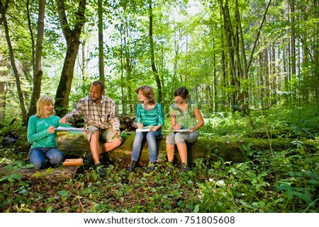 teacher and pupils at the wood #751805608