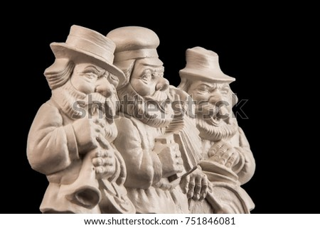 White gypsum clay painting of three male musicians in national clothes #751846081