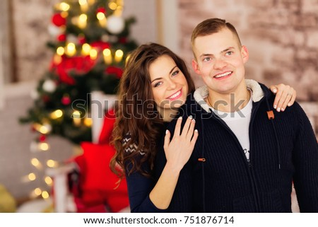 people, christmas, holidays and new year concept - happy family couple in sweaters over holidays lights background #751876714