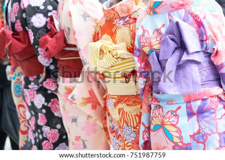 """Young girl wearing Japanese kimono standing in front of Sensoji Temple in Tokyo, Japan. Kimono is a Japanese traditional garment. The word """"kimono"""", which actually means a """"thing to wear""""  Royalty-Free Stock Photo #751987759"""