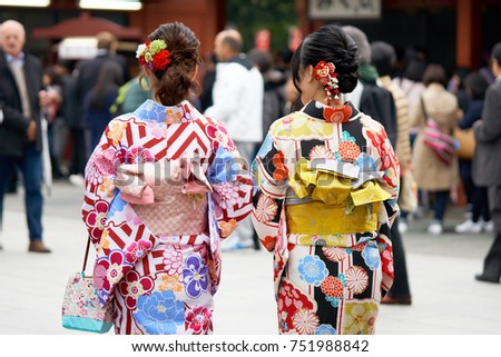 "Young girl wearing Japanese kimono standing in front of Sensoji Temple in Tokyo, Japan. Kimono is a Japanese traditional garment. The word ""kimono"", which actually means a ""thing to wear"" Royalty-Free Stock Photo #751988842"