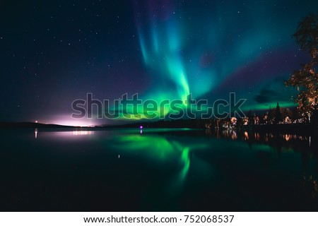 Beautiful picture of massive multicolored green vibrant Aurora Borealis, Aurora Polaris, also know as Northern Lights in the night sky over Norway, Scandinavia  #752068537