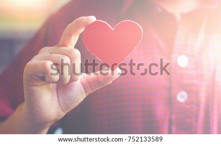 Red Paper cut heart shape hold by hand positive Intent symbol Senior caring work life balance love and charity life insurance health protection concept slogan take care of yourself For longevity #752133589