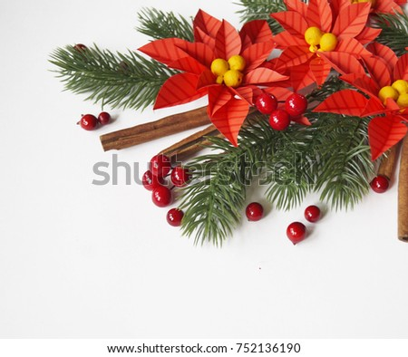 Paper flower poinsettia and spruce branches. Christmas composition. White background. Colors are green, red, yellow. #752136190